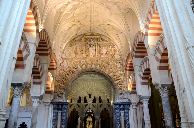 Mezquita Great Cathedral and Mosque in Cordoba is church built inside of an existing mosque. Below Mudejar brickwork on a church tower in Tarazona.