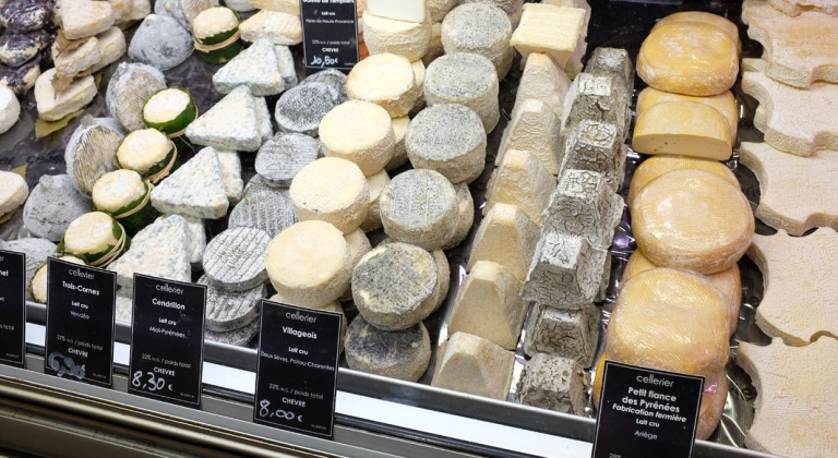 Cheese at Les Halles, including one in the shape of France.