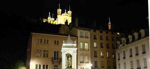 Evening view of Basilica of Notre-Dame and petite Eiffel tower on Fourvière hill in Lyon.