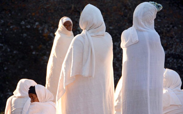 """Women gather at dawn for Sunday services. Ethiopian Christians dress for church in the all-white """"shamma."""""""