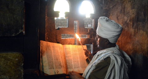 Inside the churches monks read the ancient texts using flames.