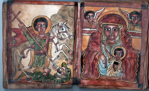 Paintings in a small gospel book, covered with wood boards. St. George is the patron saint of Ethiopia.